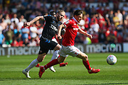 Joe Lolley (23) is challenged by Adam Clayton (8) during the EFL Sky Bet Championship match between Nottingham Forest and Middlesbrough at the City Ground, Nottingham, England on 22 April 2019.