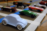 26 FEB. 2011 -- ST. LOUIS -- Pinewood derby race cars wait on the starting grid before the first race of the Adult Pinewood Derby sponsored by the Men's Club at Our Lady of Sorrows Catholic Church in St. Louis Saturday, Feb. 26, 2011. Proceeds from the event went to support Boy Scouts of America. Image (c) copyright 2011 Sid Hastings.