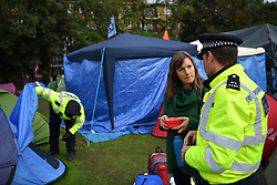 """© Licensed to London News Pictures. 15/10/2019. London, UK. The XR camp at Vauxhall Pleasure Gardens in South London is cleared by police under a revised section 14 order issued on Monday night that stated """"any assembly linked to the Extinction Rebellion 'Autumn Uprising' ... must now cease their protests within London"""" .  Photo credit: Guilhem Baker/LNP"""