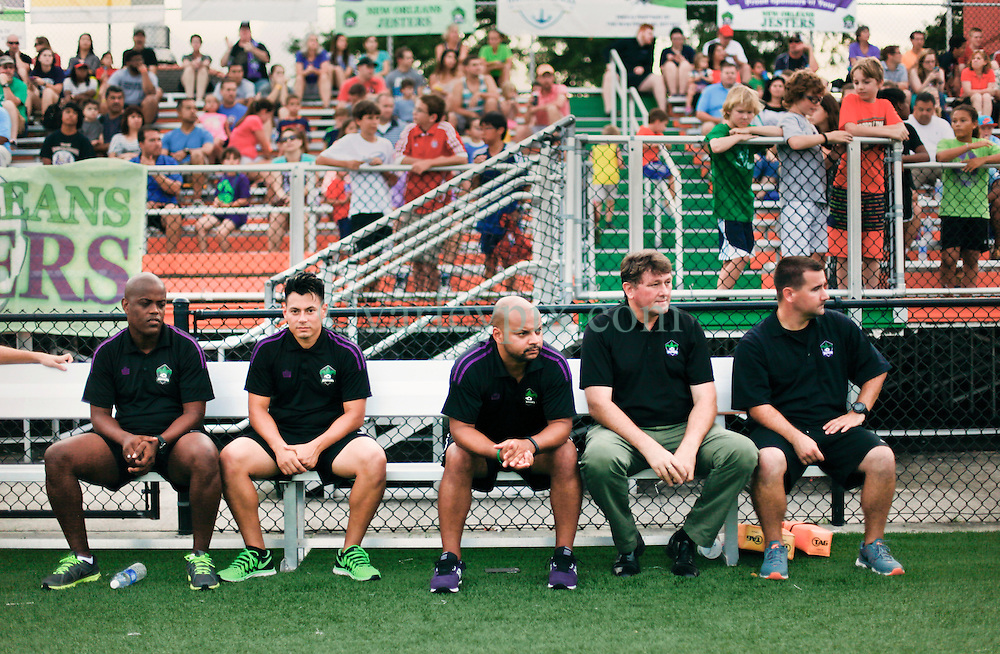 13 June 2015. New Orleans, Louisiana.<br /> National Premier Soccer League. NPSL. <br /> Manager Kenny Farrell (2nd rt) leads the bench in the minutes before kick off. The New Orleans Jesters play against Texas' Premier Soccer League&rsquo;s (TPSL) runner-up, Houston Hurricanes at home in the Pan American Stadium. Jesters take a 3-1 victory at the final whistle. <br /> Photo; Charlie Varley/varleypix.com