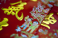 Traditional decorative Chinese writing and script on  celebratory Red Envelopes.