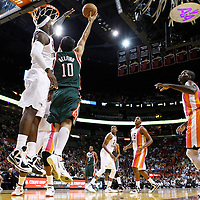 22 January 2012: `Milwaukee Bucks small forward Carlos Delfino (10) goes for the layup against Miami Heat small forward LeBron James (6) during the Milwaukee Bucks 91-82 victory over the Miami Heat at the AmericanAirlines Arena, Miami, Florida, USA.