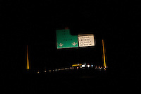 Kairouan, Tunisia - 17 December, 2011: A sign on the highway indicates the exit for Kairouan, the hometown of Said Ferjani, 57, senior member of the political and communication bureau of the Nahda (Renaissance) party, nearby Kairouan, Tunisia on 17 December, 2011. In the 24 October 2011 Tunisian Constituent Assembly election, the first elections since the Tunisian Revolution, the party won 40% of the vote, and 89 of the 217 assembly seats, far more than any other party. Said Ferjani started his activism in the Negra mosque of his hometown Kairouan when he was 16 years old, debating on politics, philosophy, economy and world events. In 1989 former dictator Zine El Abidine Ben Ali turned against Nahda (or Ennahda) and jailed 25,000 activists. Said Ferjani was jailed and tortured. He then flew Tunisia and moved to the UK. He came back to Tunisia after 22 years, after former dictator Ben Ali flew the country.<br /> <br /> Gianni Cipriano for The New York Times