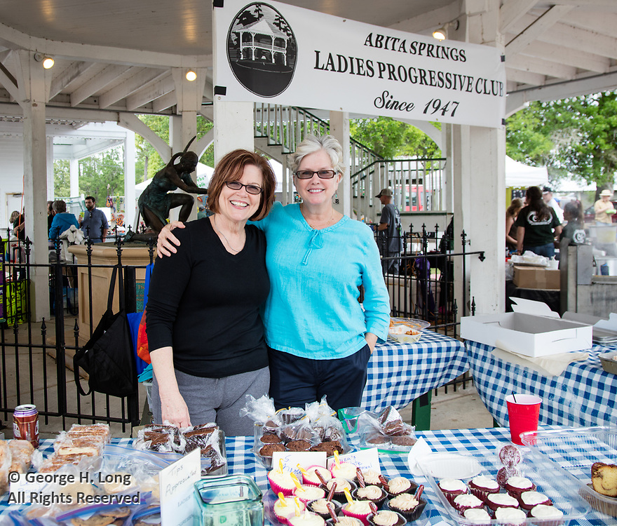 Geralyn Lips and Courtney Blitch sell sweets as a fundraiser for the Abita Springs Ladies Progressive Club at the Abita Springs Busker Festival on April 17, 2016