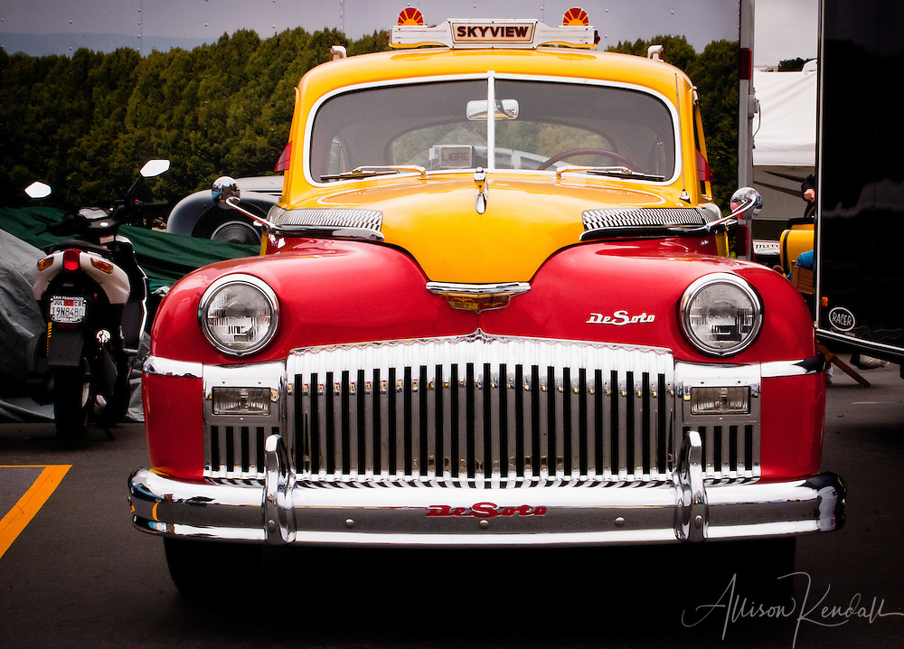 A colorful DeSoto Skyview cab on display at Laguna Seca during the Reunion events of Monterey Car Week