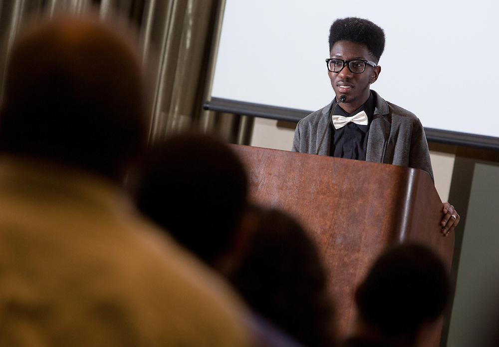 Marcus Cole reads a poem during the first-ever Men of Black Excellence Awards at Ohio Univesity, held on April 13, 2014, in Walter Rotunda. The ceremony recognized African American students in categories such as academics, campus involvement, and the performing arts, among others, and featured keynote speaker Aaron Jeter. Photo by Lauren Pond