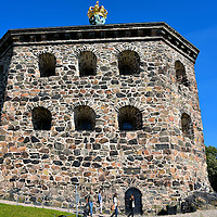 Skansen Kronan Fortress in Gothenburg, Sweden<br /> Part of Gothenburg&rsquo;s defense against the Danes in the late 17th century was the construction of two fortifications called redoubts. The stationed soldiers could easily defend themselves with over 20 cannons. Skansen Kronan means Crown Keep. The fort has six-sided, 15 foot walls made from granite with a gilded cross at the pinnacle. The fortress is perched high on Ris&aring;sberget Hill overlooking Skansberget Park and the city below. Not a single shot was ever fired during battle. Today, Skansen Kronan houses a museum and serves as a special event center for weddings and meetings.
