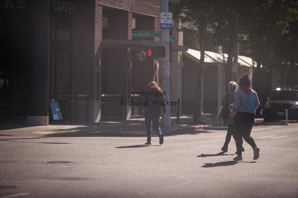 2016 October 11 - Pedestrians cross the, Alaska Junction, West Seattle , Seattle, WA, USA. By Richard Walker