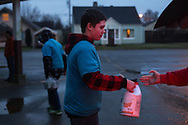 (Gabe Green   The Daily World)<br /> <br /> Josh burgher, 14, with Boy Scout troop 100 helps unload cleaning supplies from a vehicle early Saturday morning outside of Olympic Stadium where volunteers from throughout the region gathered to participate in a community-wide cleanup effort which provided relief to victims of last week's flooding and land slides.