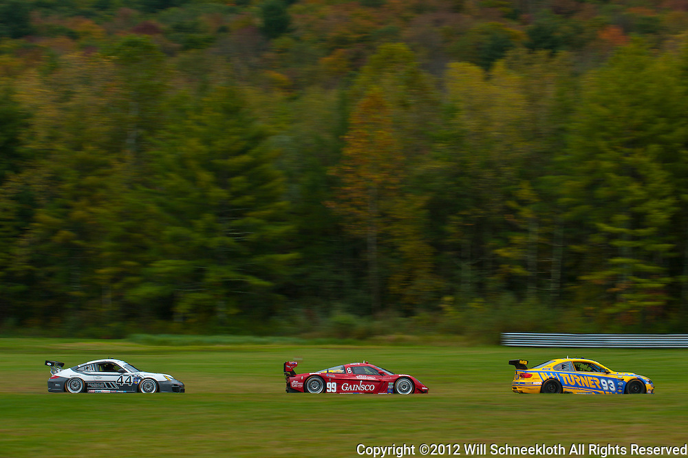 From left to right: The Magnus Racing Porsche 911 GT3 Cup driven by John Potter and Andy Lally trails the GAINSCO/Bob Stallings Racing Chevrolet Corvette DP driven by Jon Fogarty and Alex Gurney and the Turner Motorsport BMW M3 driven by Will Turner and Michael Marsal during the Grand-Am Rolex Sports Car Series Championship weekend at Lime Rock Park in Lakeville, Conn.