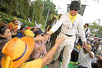 "BANGKOK, THAILAND  -  March 14: Sondhi Limthongkul who is one of the leaders of the movement against Thailand Prime Minister Thaksin Shinwatra greets supporters as tens of tousands of demonstrators seeking the resignation of Prime Minister Thaksin Shinawatra marched to government house on March 14, 2006 in Bangkok, Thailand. Marching several kilometers from the Grand Palace to Government House the protesters surrounded Thaksin's office chanting ""Thaksin Get Out"", as the Prime Minister threatened a state of emergency if the demonstration turned violent.  (Photo by David Paul Morris)"