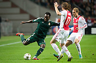 Real Madrid's Michael Essien     vies with Ajax Amsterdam's           Daley Blind   during the UEFA Champions League Group D football match Ajax Amsterdam vs Real Madrid on October 3, 2012 AFP PHOTO/ ROBIN UTRECHT.