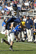 December 31, 2007 - Fort Worth, TX...Wide receiver Lavelle Hawkins #7 of the California Golden Bears leaps over defensive back Garrett Ryback #39 of the Air Force Falcons for a first down in the third quarter, during the Bell Helicopter Armed Forces Bowl at Amon G. Carter Stadium in Fort Worth, Texas on December 31, 2007...The Golden Bears defeated the Falcons 42-36.  .Peter G. Aiken/CSM