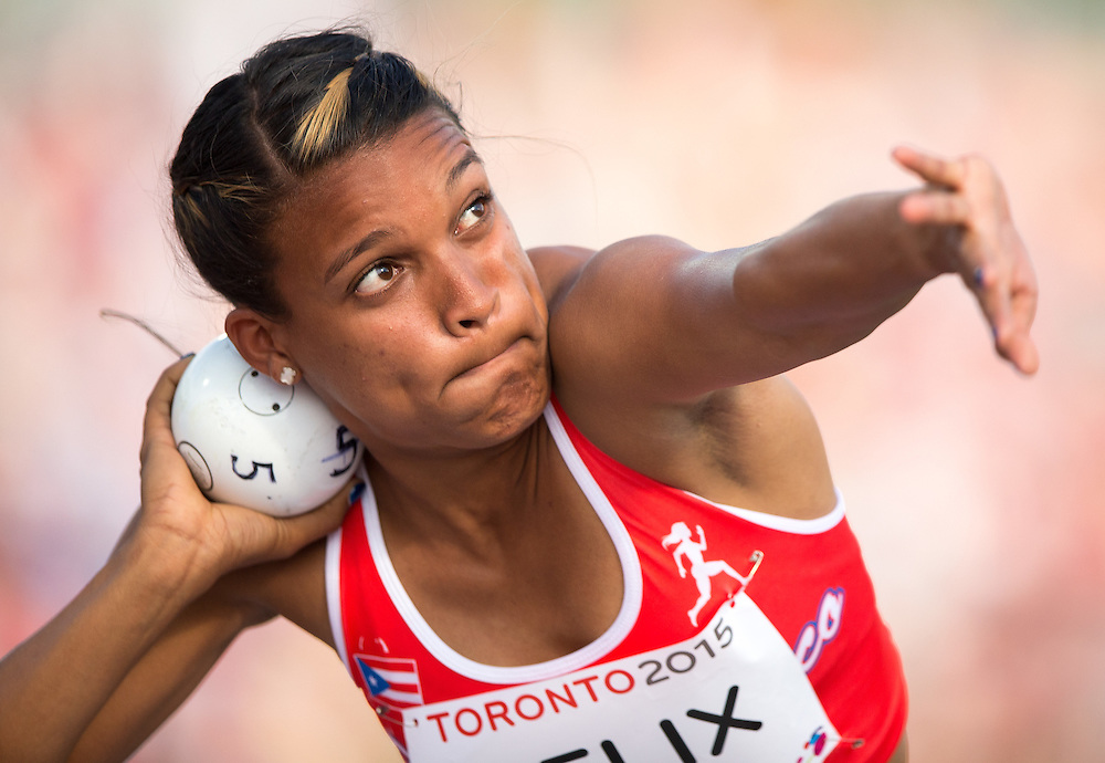 Alysbeth Felix of Puerto Rico throws the shot put during the women's heptathlon competition at the 2015 Pan American Games at CIBC Athletics Stadium in Toronto, Canada, July 24,  2015.  AFP PHOTO/GEOFF ROBINS