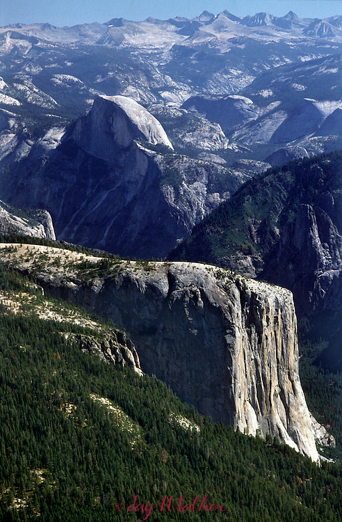 Yosemite National Park with El Capitan and Half Dome.  Aerial photo also show the high Sierra including Mt. Banner an Mt. Ritter on the skyline.