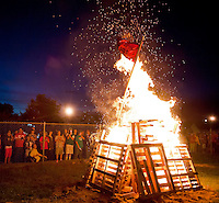 Dormant for well over 20 years the bonfire tradition was rekindled to kick off Homecoming festivities for Laconia High School on Thursday evening.  (Karen Bobotas/for the Laconia Daily Sun)