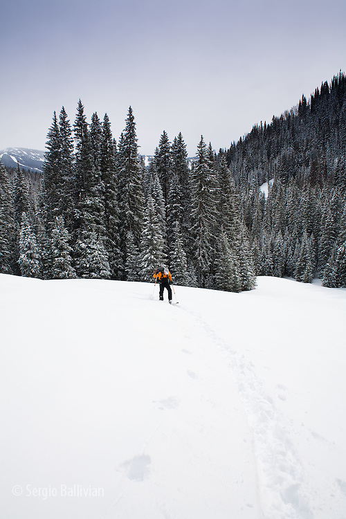 A lone man tours on skis to the Eiseman Hut near Vail, Colorado.