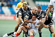 Hull's Sika Manu, Danny Houghton and Steve Michaels stop Widnes' Corey Thompson during the Super 8s Round 2 match between Widnes Vikings and Hull FC at the Select Security Stadium, Halton, United Kingdom on 11 August 2016. Photo by Craig Galloway.