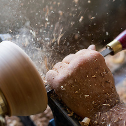 083013       Brian Leddy<br /> Dust and wood chips fly as David Baker works a bowl on a lathe in his shop Friday.
