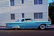 A space-age, 1961 Plymouth Savoy in  South Beach. Both the car and the Deco building behind it show strong streamlining.