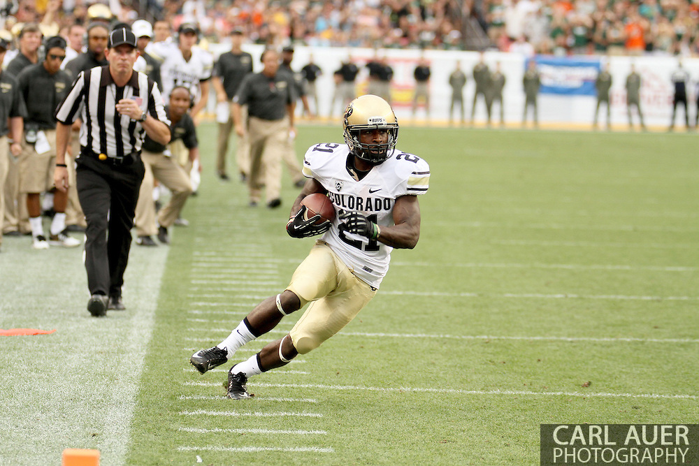 September 1st, 2013 - Colorado Buffaloes junior wide receiver D.D. Goodson (21) runs down the sidelines towards the end zone in the second half of the NCAA football game between the Colorado Buffaloes and the Colorado State Rams at Sports Authority Field in Denver, CO