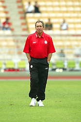 BANGKOK, THAILAND - Thailand. Thursday, July 24, 2003: Liverpool's manager Gerard Houllier pictured before a preseason friendly match against Thailand at the Rajamangala National Stadium. (Pic by David Rawcliffe/Propaganda)