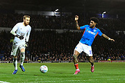 Ellis Harrison (22) of Portsmouth closes in on Will Norris (12) of Ipswich Town during the EFL Sky Bet League 1 match between Portsmouth and Ipswich Town at Fratton Park, Portsmouth, England on 21 December 2019.
