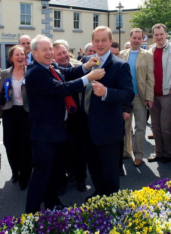Fine Gael Leader Enda Kenny is presented with a flower by Michael Ring T.D. on a walk about through the tidiest town in Ireland, Westport. Pic: Michael Mc Laughlin