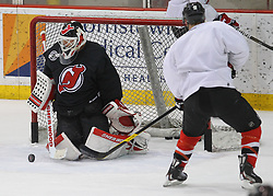 May 29; Newark, NJ, USA; New Jersey Devils goalie Martin Brodeur (30) makes a save on New Jersey Devils left wing Zach Parise (9) during Stanley Cup Finals media practice day at the Prudential Center.