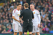 Ander Herrera of Manchester United and Wayne Rooney of Manchester United appeal to Referee Mike Jones during the Barclays Premier League match between Crystal Palace and Manchester United at Selhurst Park, London, England on 31 October 2015. Photo by Phil Duncan.