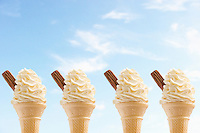 Row of four icecreams against sky