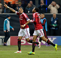 Football - Champions League - AC Milan vs. Arsenal<br /> Kevin Prince Boateng and Robinho celebrate AC Milan's third goal