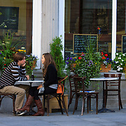 Young couple sits at table outside bistro, Old Town, Montreal, Quebec, Canada