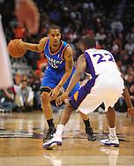 Feb. 4, 2011; Phoenix, AZ, USA; Oklahoma City guard Russell Westbrook (0) handles the ball against the Phoenix Suns at the US Airways Center. Mandatory Credit: Jennifer Stewart-US PRESSWIRE