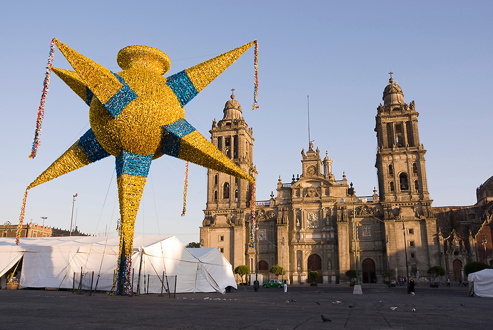 Mexico City-Jan 13: Yellow & blue sparkling Christmas star decoration dominates the town square on 13 Jan in Zocalo, Mexico City Distrito Federal