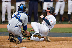 Virginia Cavaliers outfielder Brandon Marsh (9) is tagged out on a play at home plate by Duke Blue Devils Catch Matt Williams (18).  The Virginia Cavaliers Baseball team defeated the Duke Blue Devils 8-1 in the final game of a three game series at Davenport Field in Charlottesville, VA on April 8, 2007. The win secured a 2-1 series victory over the Blue Devils.