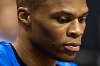 OKLAHOMA CITY, OK - APRIL 21: Russell Westbrook #0 of the Oklahoma City Thunder on the bench in thought before a game against the Portland Trail Blazers during Round One Game Three of the 2019 NBA Playoffs on April 21, 2019 at Chesapeake Energy Arena in Oklahoma City, Oklahoma  NOTE TO USER: User expressly acknowledges and agrees that, by downloading and or using this photograph, User is consenting to the terms and conditions of the Getty Images License Agreement.  The Trail Blazers defeated the Thunder 111-98.  (Photo by Wesley Hitt/Getty Images) *** Local Caption *** Russell Westbrook