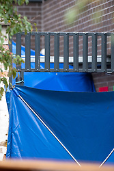 © Licensed to London News Pictures. 25/09/2019. Headington, UK. A forensic tent seen at Foresters Tower after reports of a man falling from an upper floor. Thames Valley Police were called to Foresters Tower in Wood Farm Road, Headington, at 21:18 BST on 24th September 2019 to reports that a man had fallen from an upper floor of Foresters Tower. The man died at the scene. <br /> Following a search of flats at Foresters Tower, a woman was located on the fourth floor with severe neck injuries and was pronounced dead at the scene.. Photo credit: Peter Manning/LNP