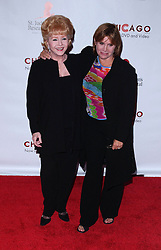 File photo dated 8/19/03 of Debbie Reynolds and Carrie Fisher who has died at age 60