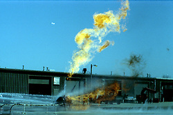 Controlled LP tank burn for a training session held at the Town of Normal garage lot on Warriner St.  Hicksgas supplied the fuel, Rocket Supply built and supplied the tank sled.  Several fire departments participated.  Date was 1982 or 1983.<br /> <br /> This image was scanned from a slide, print or transparency.  Image quality may vary.  Dust and other unwanted artifacts may exist.
