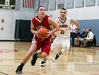Laconia's Cam Magerer and Belmont's Matt Pluskis charge down court during NHIAA Division III Basketball on Tuesday evening.  (Karen Bobotas/for the Laconia Daily Sun)