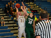 Gilford's Shane Podmore goes up for a shot against Raymond's Conor Cole during NHIAA Division III Basketball at Gilford High School on Tuesday evening.  (Karen Bobotas/for the Laconia Daily Sun)