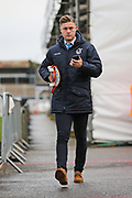 Bristol Rovers James Clark (15) arriving at the ground with a skate board before the EFL Sky Bet League 1 match between Bristol Rovers and Doncaster Rovers at the Memorial Stadium, Bristol, England on 23 December 2017. Photo by Gary Learmonth.