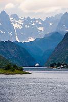 Norway, Lofoten. Raftsundet is a 20km long strait separating Austvågøya and Hinnøya. Hurtigruta entering Trollfjorden.