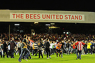 London - Tuesday, 21st September, 2010: Brentford fans invade the pitch after victory in the the Carling Cup 3rd Round match at Griffin Park, London...Pic by: Alex Broadway/Focus Images