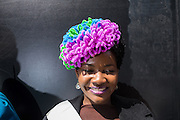 New York, NY, USA-27 March 2016. Milliner Lisa McFadden wears one of her hats, decorated in colorful , oversized, pipe cleaners, on Fifth Avenue in the annual Easter Bonnet Parade and Festival. Ms. McFadden was there with a group from the Milliners Guild.