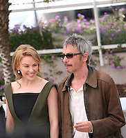 Kylie Minogue and  Leos Carax  at the Holy Motors photocall at the 65th Cannes Film Festival France. Wednesday 23rd May 2012 in Cannes Film Festival, France.