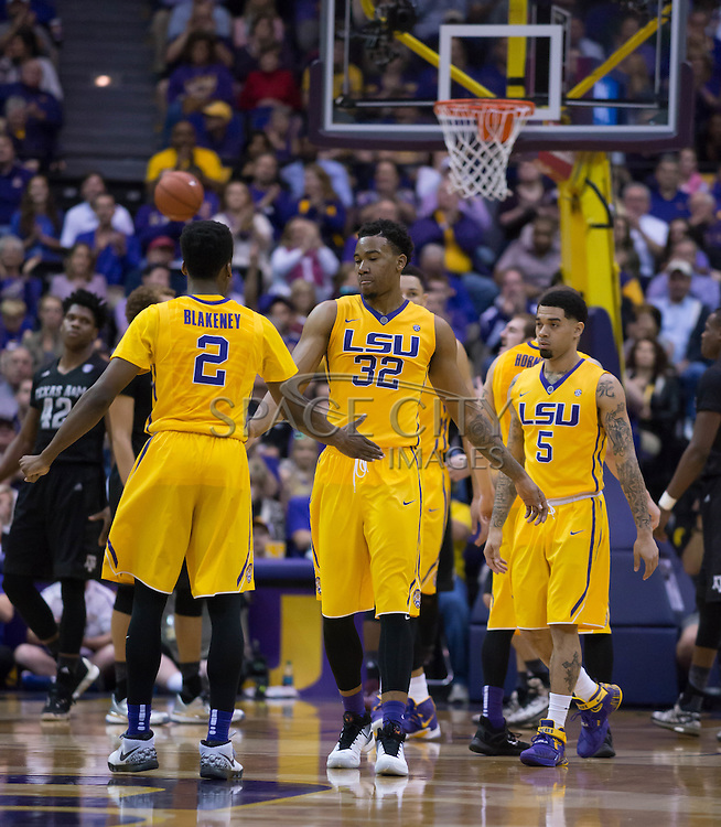 Craig Victor(32) and Antonio Blakeney(2) slaps hands after a foul call. LSU defeats Texas A&M 76-71 in Baton Rouge, Louisiana. Photo BY: Jerome Hicks/ Space City Images
