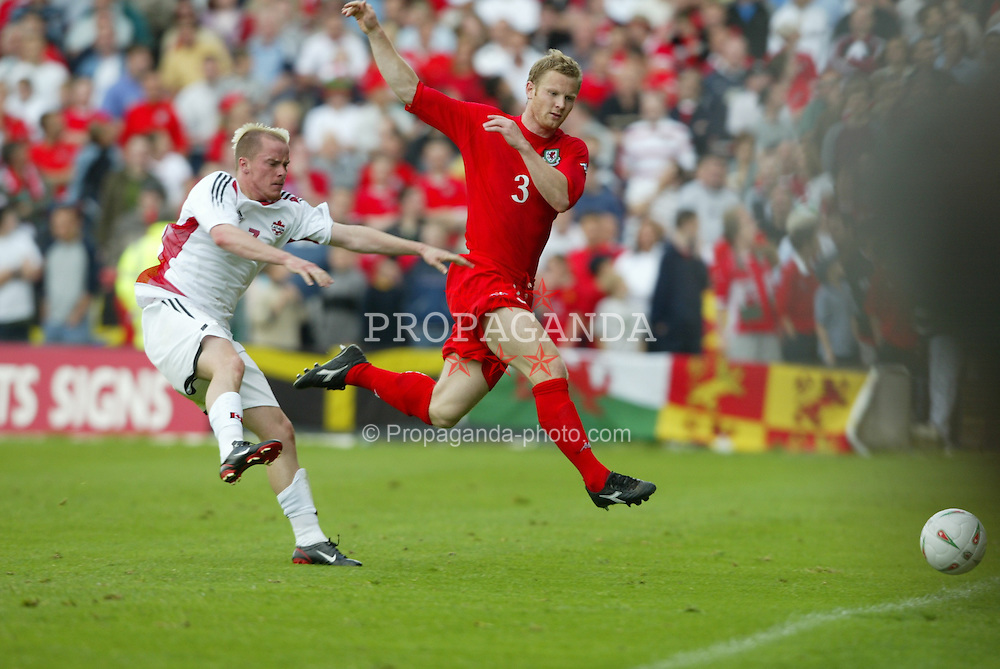 WREXHAM, WALES - SUNDAY MAY 20th 2004:  Wales' Ben Thatcher and Canada's Iain Hulm during the friendly match at the Racecourse Ground, Wrexham. (Photo by David Rawcliffe/Propaganda)