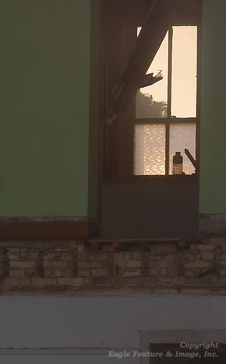 A water bottle sits on a window sill inside what was left of the Holy Childhood building in Harbor Springs as it was being torn down.